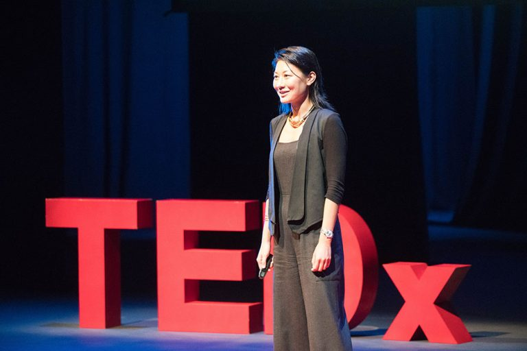 Daisy Tam on stage at Tedx Wan Chai 2017
